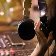 Woman-music-producer-holding-headphone